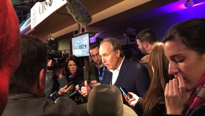 Christopher Isham of CBS News speaks to reporters Saturday in Des Moines.