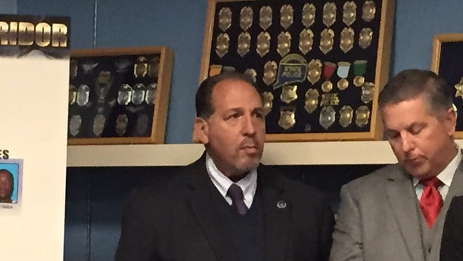 Morris County Prosecutor Fredric M. Knapp, at left.