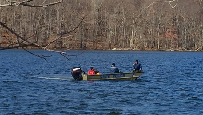 State Police search White Meadow Lake in Rockaway Township on Nov. 23, 2015 for a missing canoeist, whose body was found Nov. 24, 2015.