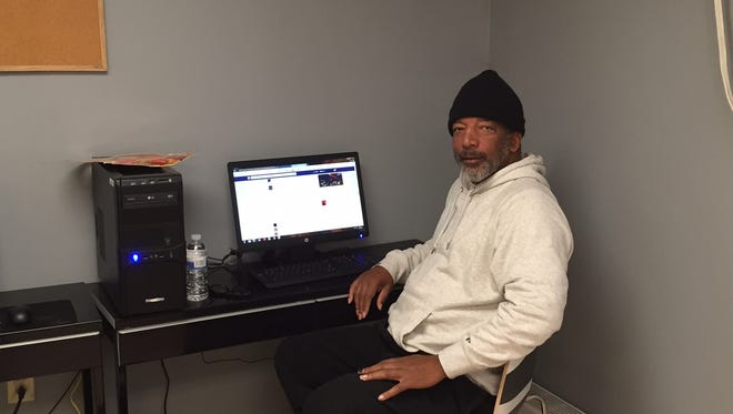 Client Luis Mendes uses the computer at Our Promise, a drop-in center for the homeless in the basement of First Baptist Church of Morristown.