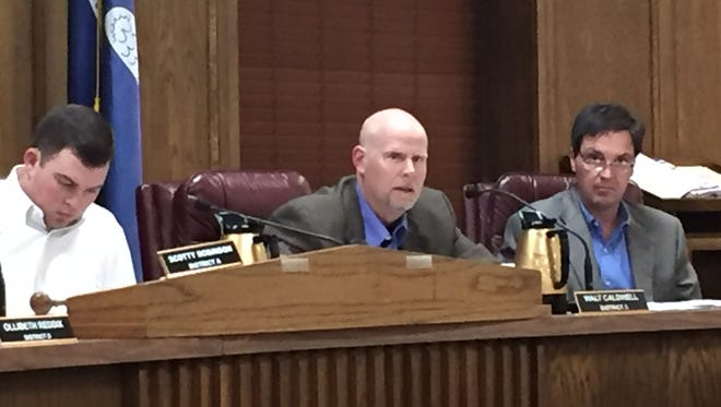 Caldwell introduces tax district ordinance in police jury meeting.