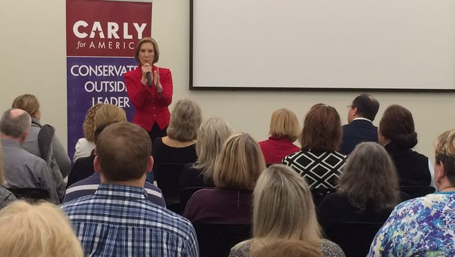 Republican presidential candidate and former Hewlett-Packard CEO Carly Fiorina speaks to about 100 people at a town hall event in Des Moines.