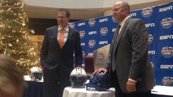 Auburn head coach Gus Malzahn and Memphis interim head