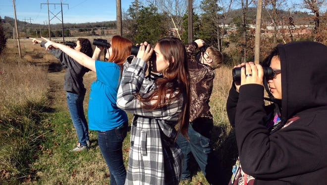 Students in Dr. Karla Bouck's zoology class at Mountain Home High School Career Academies use the binoculars they received from a grant from the Arkansas Audubon Society Trust.