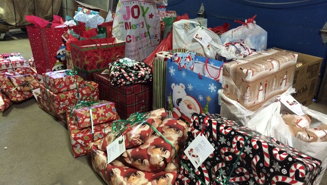Christmas presents for 40 area children, donated by members of the Door County Advocate staff and community, were delivered to Feed and Clothe My People in Sturgeon Bay Friday.