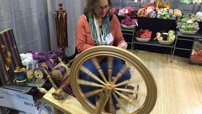 Anna Upston makes yarn from natural fiber and silk at the Holiday Craft Morristown 2015 event, Dec. 12, 2015