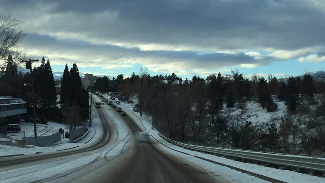 A file photo showing snow covered roads. Reno forecasters said a storm could drop up to 5 to 10 inches of snow along the Sierra by Saturday.