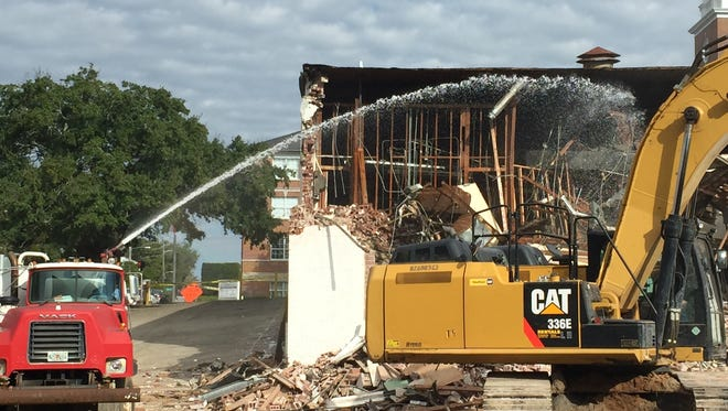 Demolition began this week for an eyesore on the corner of Duval Street and College Avenue.