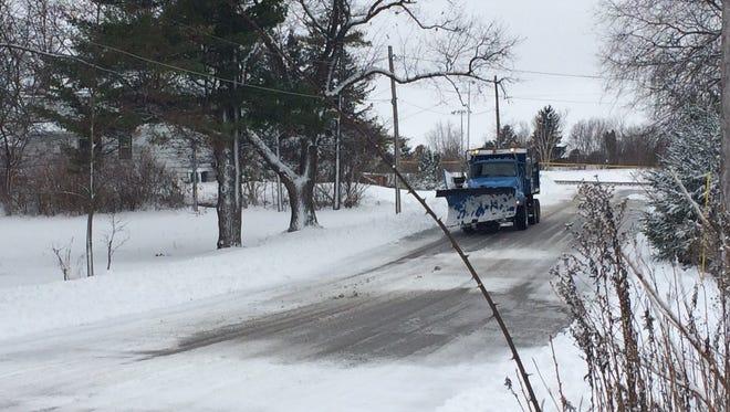 A snow plow runs through East Redwood Street in Sturgeon Bay. (File photo)