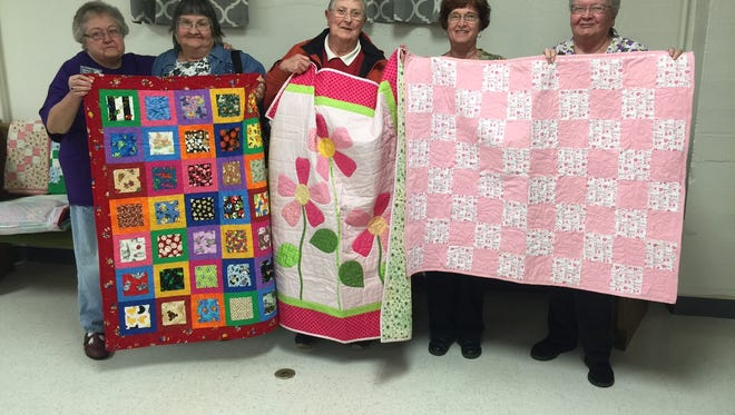 From left, Shirley Fuller, Wanda Shilling, Dorothy Weeks, Vicky Renner and Gail Ramon of the Cal-Co Quilters Guild show off their work. The group donated over 700 quilts to shelters and other organizations in 2015.