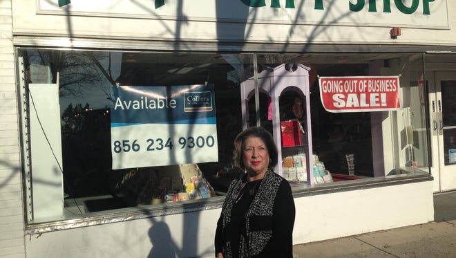 Owner Melody Manning stands in front of Peter Pan Gift Shop, which will be closing soon after nearly 50 years in business.