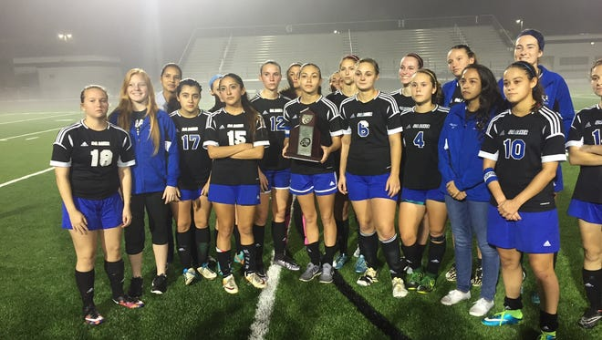 The Ida Baker girls' soccer team poses for a photo after being the runner up in District 4A-12.