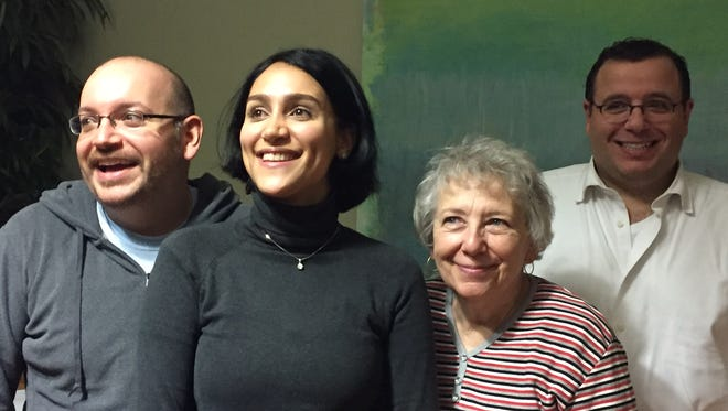In this photo provided by The Washington Post, from left, Jason Rezaian, his wife Yeganeh Salehi, his mother Mary Rezaian, and brother Ali Rezaian pose for a photo at Landstuhl Regional Medical Center in Germany Monday. Jason Rezaian was freed Saturday after almost 18 months of incarceration in an Iranian prison.