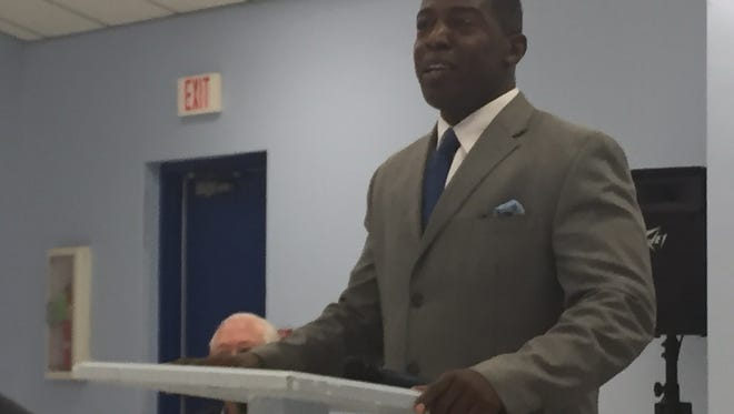 Ernest Muhammad speaking at a candidate forum earlier this month.