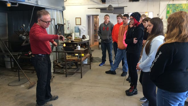 Jeremy Popelka did a quick demonstration on how to make a glass dog to Gibraltar students during their Exposure to Creativity session at Popelka Trenchard Glass in Sturgeon Bay.