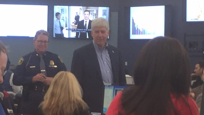 Gov. Rick Snyder, accompanies by Coll. Kriste Kibbey Etue of the Michigan State Police, toured the Emergency Operations Center in Dimondale near Lansing Monday.