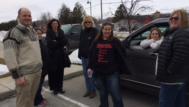 From left, parents Sean Linnan, Jamie Buesing, Stephanie Burke, Lynn Zawojski, Kristina Blackley, Bridget Isaksen and Alycia Schultz were among the Sevastopol Schools parents to turn out to speak about Mary Donaldson's taking administrative paid leave.