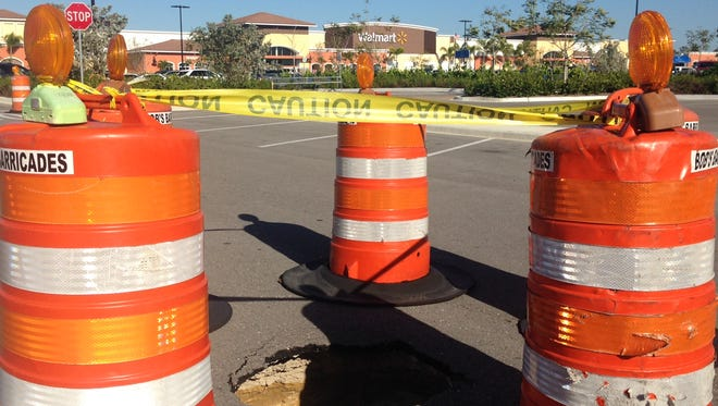 A sinkhole about three-feet by three-feet has opened in the parking lot of the Walmart in Estero.