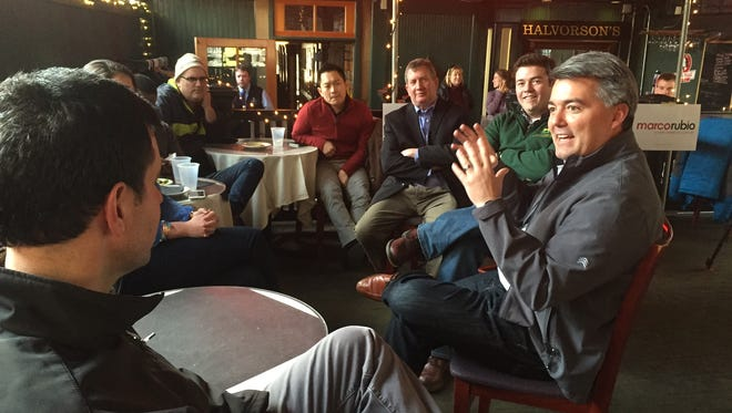 U.S. Sen. Cory Gardner, right, speaks with Vermonters who attended a Marco Rubio campaign event at Halvorson's Upstreet Cafe in Burlington on Sunday.