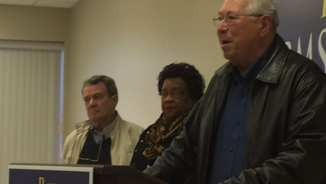 Armstrong (at podium), is joined by Marion Welch-Holston and Frank Scalia in Wednesday's news conference.