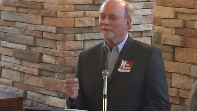 John Jones, a Senior Vice President with CenturyLink, speaks at an endorsement event for Monroe City Council candidate Jay Marx.