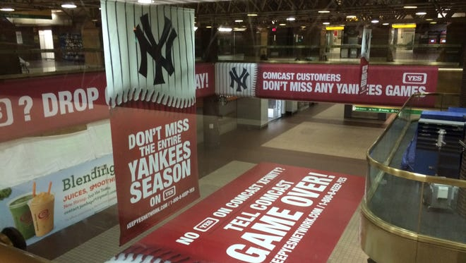 The YES Network has set up these advertisements at the Port Authority bus terminal in Manhattan to combat Comcast's decision to carry the channel which carries Yankees games.