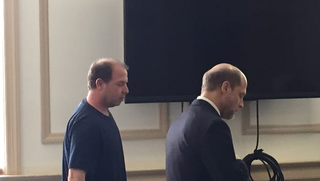 Disbarred attorney Neil Lawrence Gross, in tee shirt, stands next to defense lawyer Michael Fletcher in Superior Court, Morristown, on March 11, 2016. Gross was sentenced to prison for theft, writing bad checks and practicing law without a license.