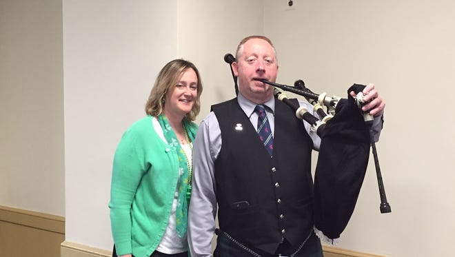 Kerri-Lynn Walsh-Wood and her husband, Keith Wood, at the Morris County courthouse on St. Patrick's Day, 2016, where Wood entertained staff with his bagpipes.
