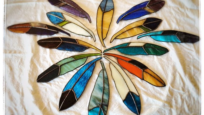 Feathers are hot in home decor this spring, and Copper Pony in Clearwater has hand-crafted stained glass feathers to fit any home.