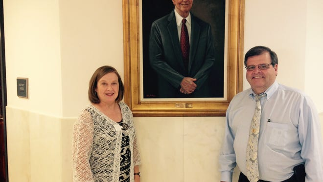 Deb Hill, left, has been appointed Autauga County Circuit Clerk. Current clerk Whit Moncrief, right, is retiring Thursday. The two are pictured in front of a portrait of the late Fred Posey that hangs in the courthouse hall. Posey served as circuit clerk for 60 years.