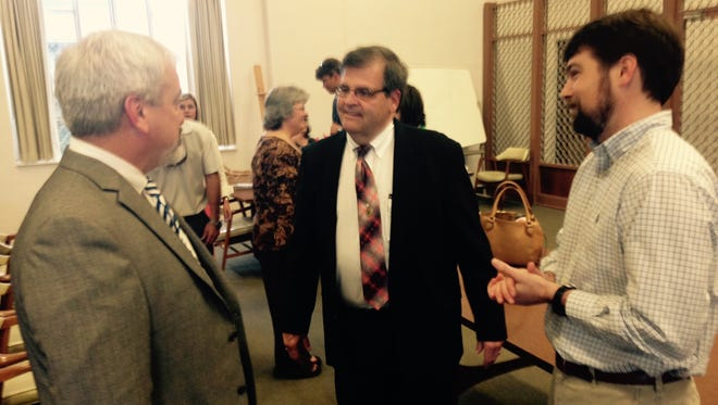 Retiring circuit clerk Whit Moncrief, center, greets well wishers before his retirement reception Wednesday.