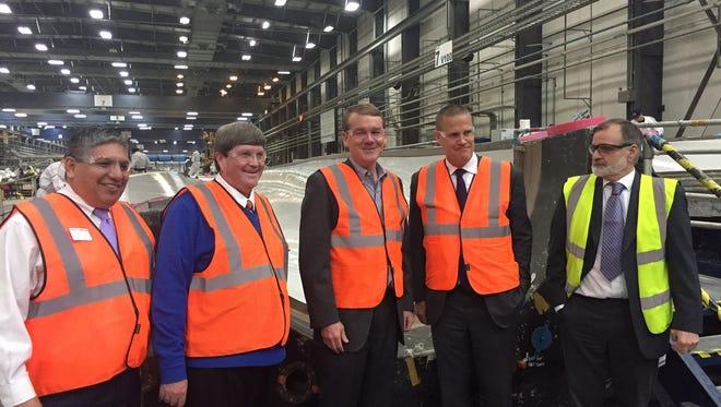 U.S. Sen. Michael Bennet, D-Colo., center, visited Vestas' Windsor  facility on Thursday.