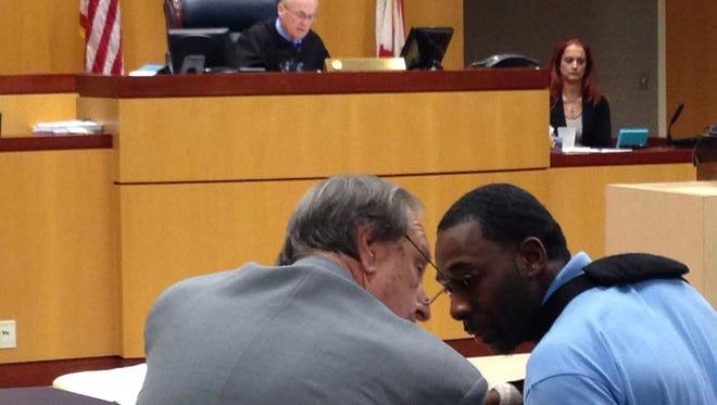 Vahtiece Kirkman, right, talks with attorney