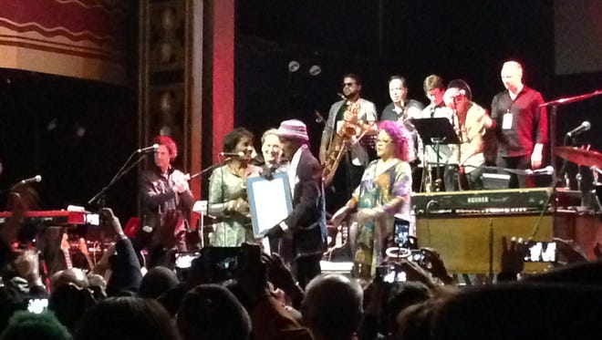 Bernie Worrell receives a proclamation from the City of Newark at the Monday, April 4 'All the Woo in he World' benefit show at Webster Hall in New York City.