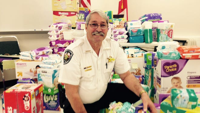 Autauga County Sheriff Joe shows off some of the loot he collected Friday at his baby shower.