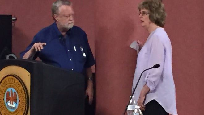 City Sewer Manager Charles Westrom listens to question from resident Paula Stidham about Monday's flooding.