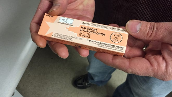 Bucyrus police Capt. Joseph Greathouse holds two doses of naloxone, or Narcan, which the department's officers have on hand at all times to reverse the effects of an opiate drug overdose.