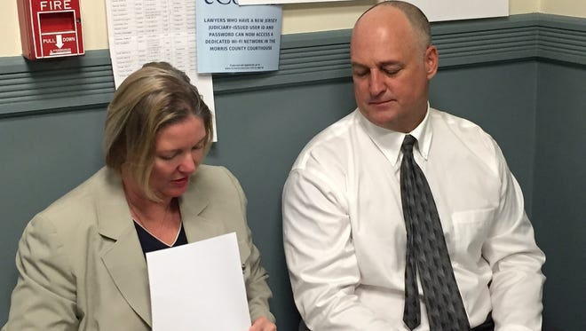 Attorney Marcy McMann confers with client James Matthews before his guilty plea April 19, 2016 to possession with intent to distribute more than 25 pounds of marijuana in Wharton.