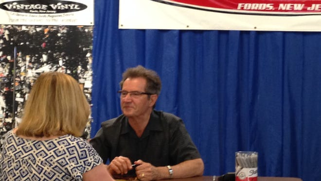Garry Tallent chats with a fan Sunday, April 24 at Vintage Vinyl in Fords.