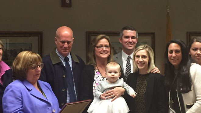 From left, Morris County Freeholder Director Kathy DeFillippo, Jim O'Brien 3rd, his wife, Patricia, holding infant Reagan O'Brien, Joe O'Brien and wife Courtney O'Brien, and Deirdre's House Executive Director Maria Vinci Savettiere.