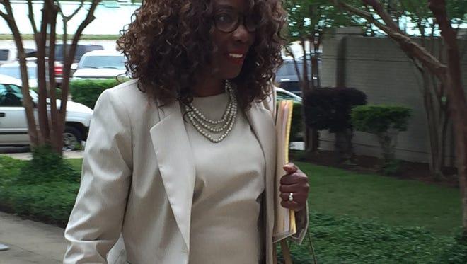 Councilwoman-elect Juanita Woods enters 4th District Court Monday.