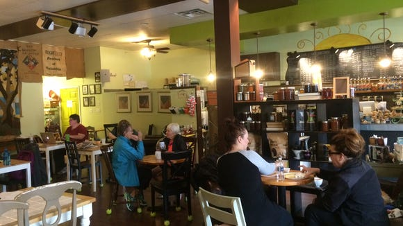 Guests enjoy coffee and breakfast at the Treehouse Coffee Shop in Audubon.