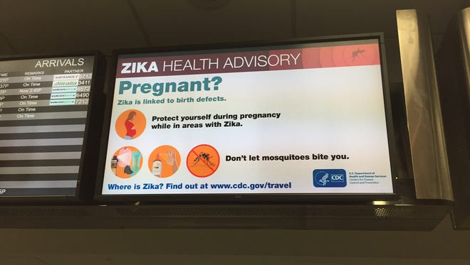At Fort Lauderdale, Zika virus information is on display screens, right next to the flight information screens.