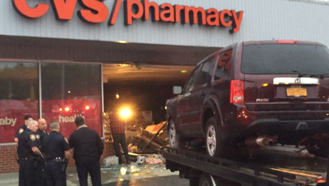 A Honda SUV crashed into a CVS in Yorktown Heights injuring five, police said