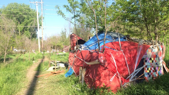 Des Moines city workers cleared out a large homeless camp near Southwest 14th and Tuttle Streets on Friday morning.
