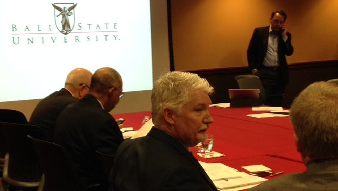 Ball State University Treasurer Bernie Hannon speaks to a colleague before Friday's board of trustees meeting.