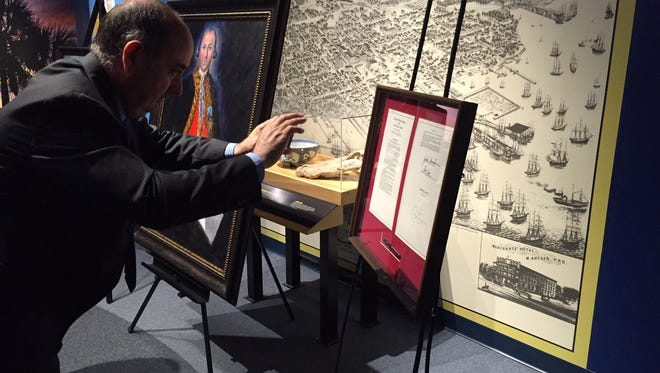 Antonio Campos, Mayor of the Spanish city of Macharaviaya,  takes a picture of  a proclamation naming Spanish Gen. Bernard de Galvez an honorary U.S. citizen.   The Galvez painting in the background is by Pensacola artist Nina Fritz