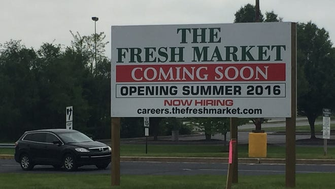 A sign at West Manchester Town Center advertises jobs available at the not-yet-built grocery store. The Fresh Market will open at the town center in summer 2016.