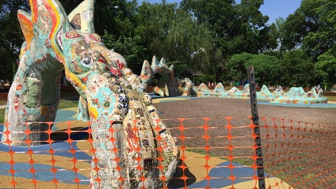 The dragon sculpture at Fannie Mae Dees Park has been fenced off for safety reasons, until it is restored.