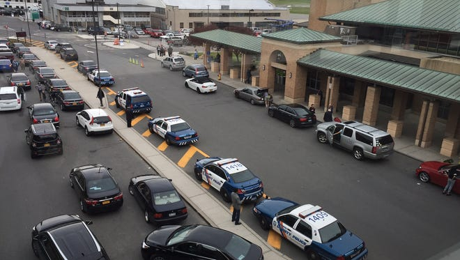Police outside Westchester County Airport after a suspicious item was found and thought to be a pipe bomb. It turned out to be barbecue sauce.